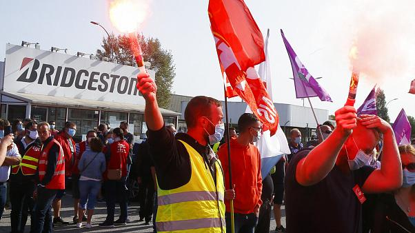 Bridgestone employees gather outside the tire factory of Bethune, northern France, Thursday, Sept.17, 2020