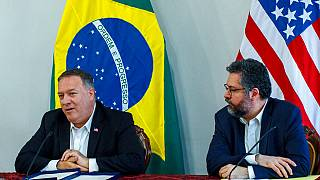 U.S. Secretary of State Mike Pompeo speaks as Brazilian Foreign Minister Ernesto Araujo looks on during a press conference at the Boa Vista Air Base in Roraima, Brazil