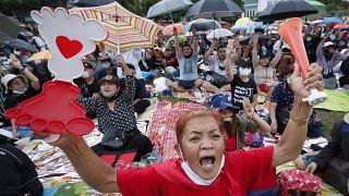 Pro-democracy activities shout slogans during a protest at Thammasat University in Bangkok, Thailand, Saturday, Sept. 19, 2020.