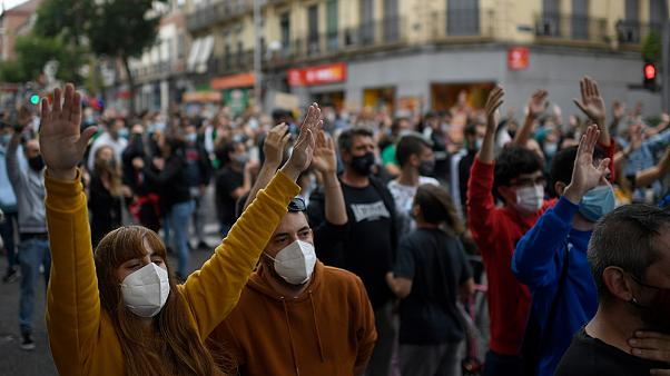 People attend a demonstration at the Vallecas neighborhood in Madrid, on September 20, 2020, to protest against the new restrictive measures.