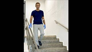 Photo taken from a video showing Alexei Navalny walking down stairs in the Berlin hospital where he is being treated.