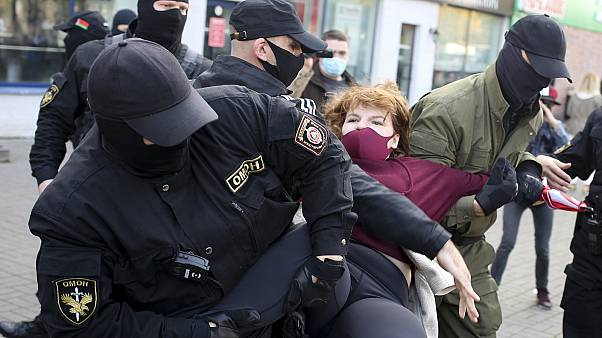 Police officers detain a woman during an opposition rally in Minsk on September 19, 2020.