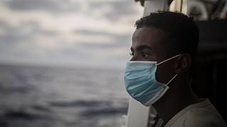 A migrant from Somalia after being rescued from the Mediterranean having fled Libya.