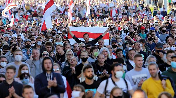 People march during a demonstration called by opposition movement for an end to the Lukashenko regime in Minsk on September 20, 2020.