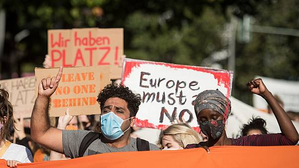 Protesters demonstrate for the evacuation of all migrant camps in Greece after the fire at the Moria refugee camp on Lesbos, on September 20, 2020, in Berlin.