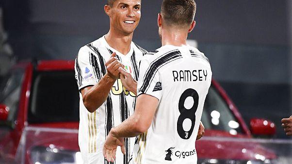 Juventus' Cristiano Ronaldo, left, celebrates his goal with teammate Aaron Ramsey during an Italian Serie A match between Juventus and Sampdoria at the Allianz Arena