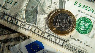 This file photo taken on January 17, 2015 shows euros and US dollar bills taken in Godewaersvelde, Northern France.