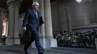 UK Prime Minister Boris Johnson walks to Downing Street in London on September 22, 2020 after attending the weekly cabinet meeting at the Foreign Office.