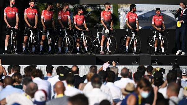 amsic riders attend the teams' presentation two days before the start of the 1st stage of the 107th edition of the Tour de France