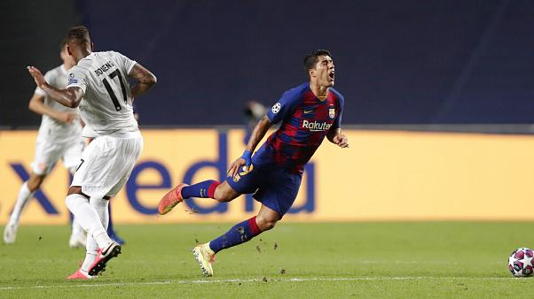 Barca striker Luis Suarez on his way to the turf in game between FC Barcelona and Bayern Munich at the Luz stadium in Lisbon, Portugal, Friday, Aug. 14, 2020