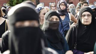 People demonstrate in Copenhagen, Denmark, Wednesday Aug. 1, 2018, as the new ban on garments covering the face is implemented.