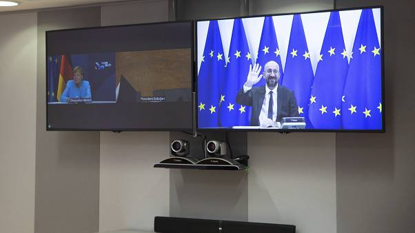 European Council President Charles Michel, screen right, waves as he attends a video conference with German Chancellor Angela Merkel, Sep 22 2020