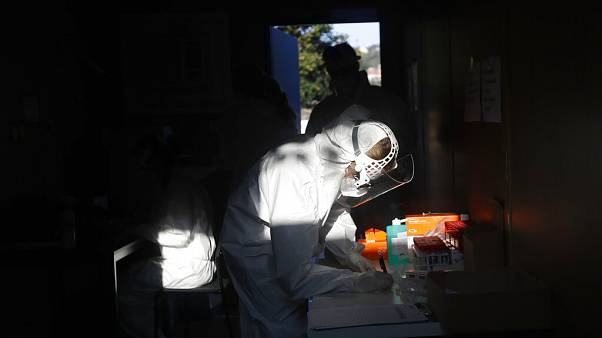 A healthcare worker at a sampling station for COVID-19 in Prague, Czech Republic, Monday, Sept. 21, 2020.