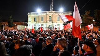 People gather for a protest called by the family of killed journalist Daphne Caruana Galizia and civic movements on December 3, 2019 outside the police HQ in Valletta.