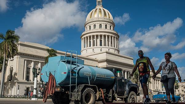 Water being delivered to houses opposite the National Capitol Building. Havana, January 4, 2020