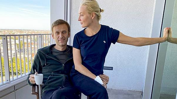 Russian opposition leader Alexei Navalny and his wife Yulia pose for a photo in a hospital in Berlin.
