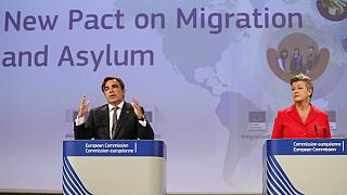 Margaritas Schinas, left, and European Commissioner for Home Affairs Ylva Johansson present the EU's New Pact on Migration and Asylum