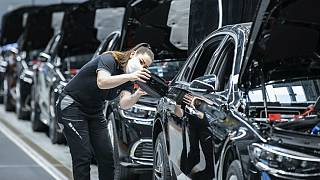 "A Mercedes-Benz employee is working on a fuel cap cover for an S-Class at the ""Factory 56"" plant in Sindelfingen, Germany"