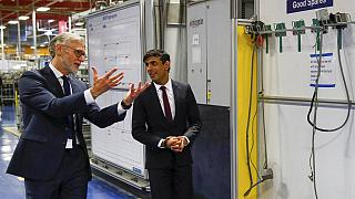 Rishi Sunak talks with the CEO of Worcester Bosch, Carl Arntzen, left, during a visit to Worcester Bosch factory to promote the initiative, Plan for Jobs