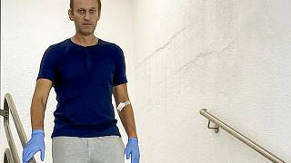 Russian opposition leader Alexei Navalny walks down stairs in a hospital in Berlin, Germany on Sept. 19, 2020.