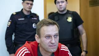 Russian opposition leader Alexei Navalny speaks to the media prior to a court session in Moscow, Russia on Aug. 22, 2019.