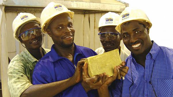 The first gold ingot poured at the Loulo Mine in Mali is displayed