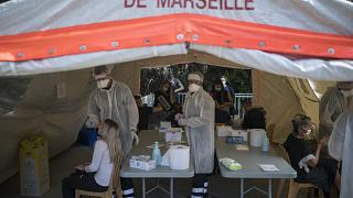 People receive COVID-19 tests at a mobile testing center in Marseille, France, Thursday Sept. 24, 2020.