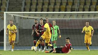 Tottenham's Tanguy Ndombele is takled by Shkendija's Arbin Zejnulai during a Europa League third qualifying round match.