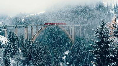 Train on viaduct in Switzerland