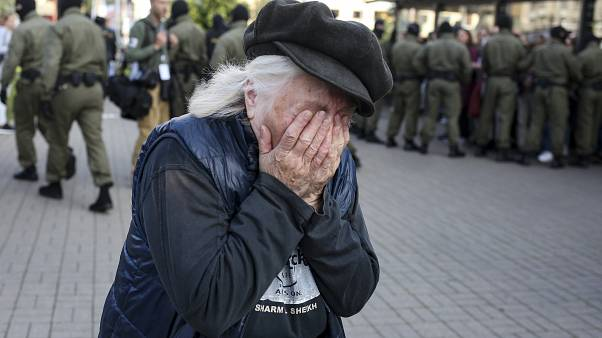An elderly woman reacts as police officers detain women during an opposition rally to protest the official presidential election results in Minsk, Belarus, Saturday, Sept. 19,