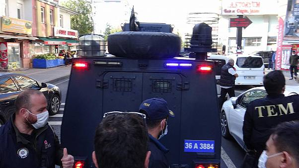 Ayhan Bilgen, the mayor of Kars, was taken away in a police van on Friday morning