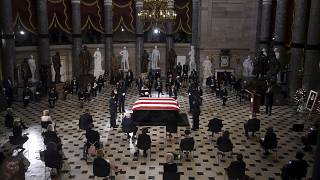 A U.S. Capitol Police honor guard surrounds the flag-draped casket of Justice Ruth Bader Ginsburg as lies in state in Statuary Hall of the U.S. Capitol, Friday, Sept. 25, 2020
