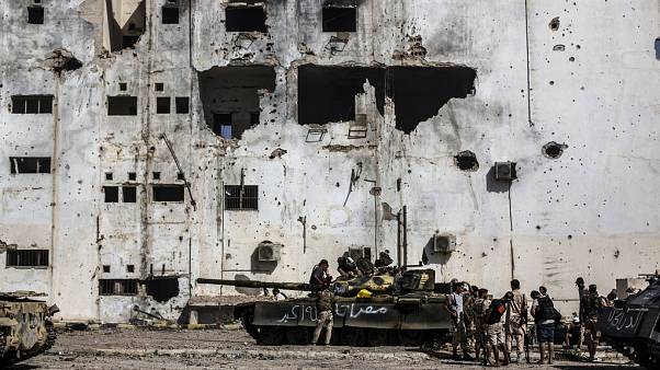 In this Sept. 22, 2016 file photo, fighters of the Libyan forces affiliated to the Tripoli government rest and reload weapons during an offensive against Islamic State.