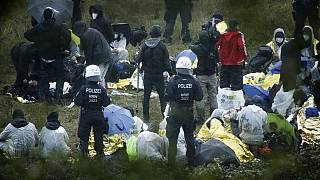 Activists are surrounded by police on the Garzweiler power plant grounds in Grevenbroich, western Germany, Saturday, Sept. 26, 2020.