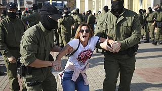 Police detain a protester during an opposition rally to protest the official presidential election results in Minsk, Belarus, Saturday, Sept. 26, 2020.