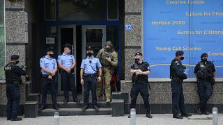 Kosovo police guard the entrance of the offices of a war veterans association in Kosovo, in Pristina.