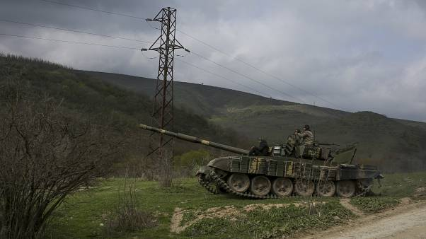 FILE PHOTO: Armenian soldiers patrol on a tank near the village of Madaghis in Nagorno-Karabakh, Azerbaijan, Wednesday, April 6, 2016.