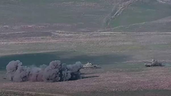 An image grab taken from a video made available on the official web site of the Armenian Defense Ministry on September 27, 2020, allegedly shows destroying of Azeri tanks.