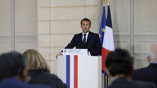 French President Emmanuel Macron speaks during a press conference on the situation in Lebanon, Sunday, Sept.27, 2020 in Paris.