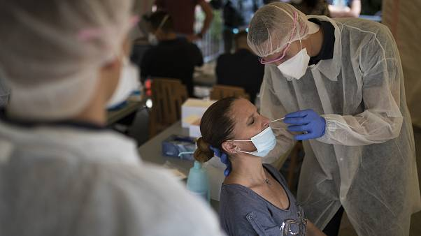 A woman is tested for COVID-19 at a mobile testing center in Marseille, France, Thursday Sept. 24, 2020.