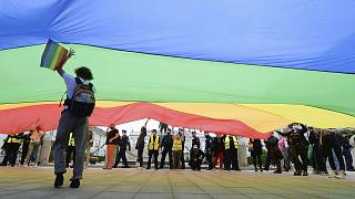 Pro-LGBT demonstrators display a huge rainbow flag as they take part in a protest against hatred towards LGBT people in Warsaw on August 30, 2020.