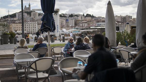 People enjoy refreshments at a restaurant, in Marseille