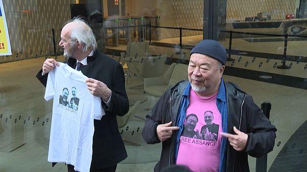 John Shipton and Ai Weiwei showing T-shirts reading 'Free Assange'