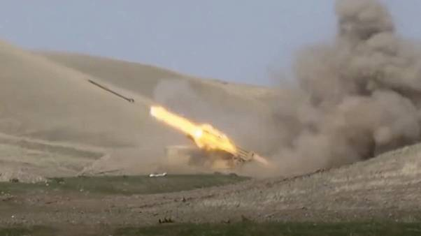 In this image taken from footage released by Azerbaijan's Defense Ministry an Azerbaijan's rocket launches from missile system at the contact line of Nagorno-Karabakh