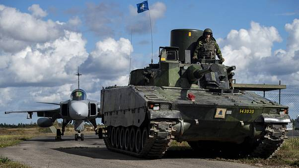 In this photo provided by the Swedish Armed Forces on Tuesday, Aug. 25, 2020, troops prepare in the Baltic Sea region.