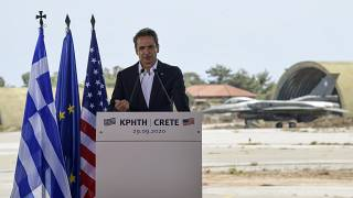 Greek Prime Minister Kyriakos Mitsotakis delivers a speech during his visit at the Naval Support Activity base at Souda