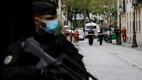Police guard a street near the scene of the knife attack