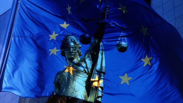EU flag and justice symbol