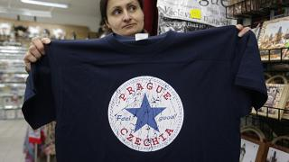 "A vendor displays a t-shirt with the word ""Czechia"" in a store in Prague, Czech Republic, Thursday, April 14, 2016."