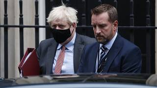 Boris Johnson flanked by his bodyguard leaves 10 Downing Street for the House of Commons.